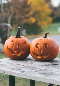 Two little pumpkins hang out and discuss zero waste candy